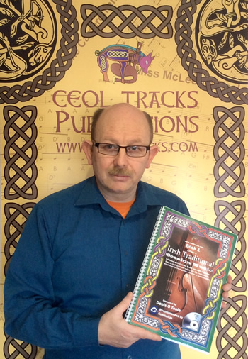 Denis O'Toole holding a copy of the successful tune Tutor book from Ceol Tracks